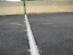 Expansion joint sealed using Belzona 4521 (Magma-Flex Fluid) whilst minimizing traffic disruption